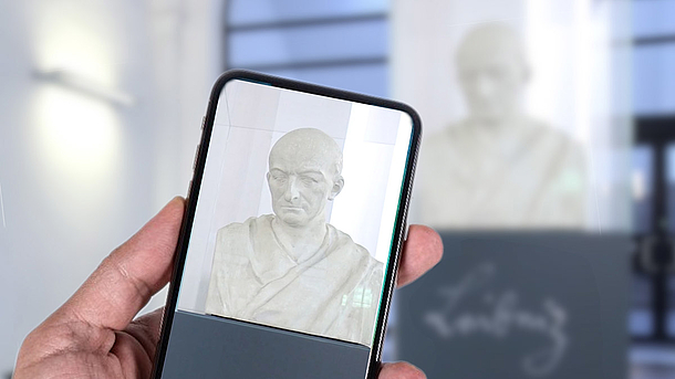Leibniz bust being photographed with a mobile phone